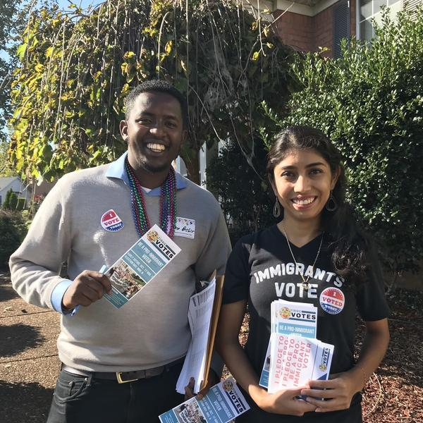 Volunteers Kayo Beshir, left, and Jazmin Ramirez, right, knock on doors in Antioch, Tenn., in an effort to get pro-immigrant voters to the polls.