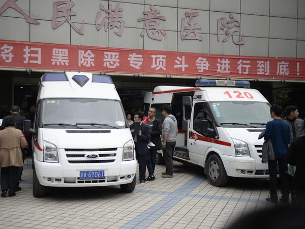 Ambulance cars take injured children to a hospital after several kindergartners were stabbed by a woman on Friday in Chongqing, China.