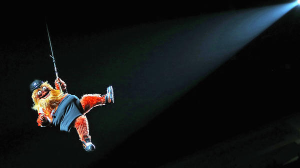 """Even rappelling from the rafters of the Philadelphia Flyers' arena, swinging to the tender tuneful power of Miley Cyrus' """"Wrecking Ball,"""" Gritty can see you. He can see your soul."""
