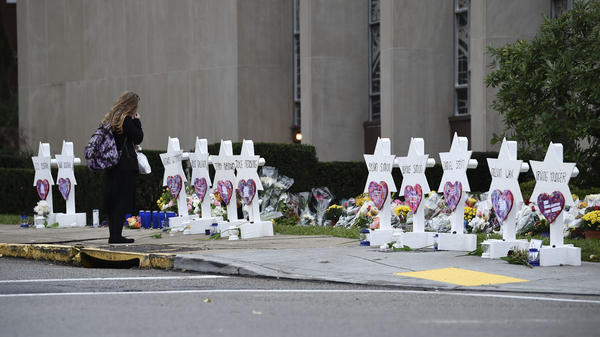 A woman stands at a memorial outside the Tree of Life synagogue after a shooting there left 11 people dead in the Squirrel Hill neighborhood of Pittsburgh on Saturday.