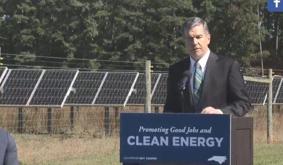 Gov. Roy Cooper spoke in Cary just before signing an executive order to fight climate change.