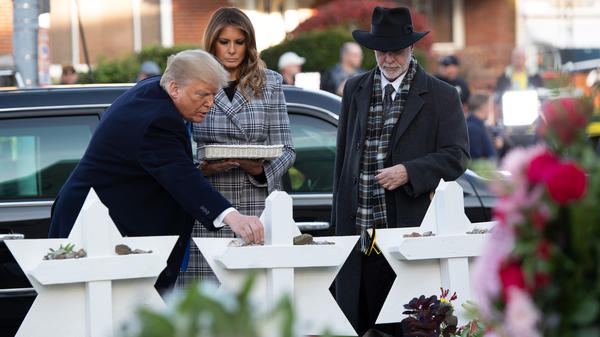 President Trump and first lady Melania Trump, alongside Rabbi Jeffrey Myers, place stones on a memorial as they pay their respects at the Tree of Life Synagogue in Pittsburgh on Tuesday.