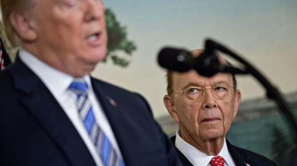 Commerce Secretary Wilbur Ross listens to President Trump at the White House in March. Ross' decision to add a question about U.S. citizenship status to the 2020 census sparked six lawsuits from dozens of states, cities and other groups that want the question removed.
