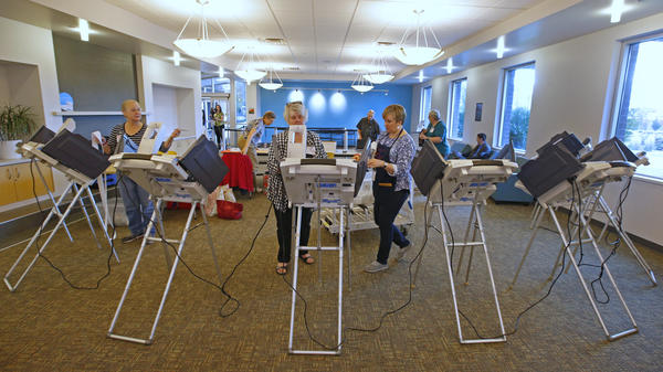 Poll workers set up voting machines for early voting in Provo, Utah, in 2016.