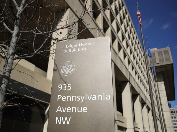 FBI leaders hoped to move to a larger new headquarters outside of Washington, but a new plan would replace the current headquarters on the same site. Democrats want more information.