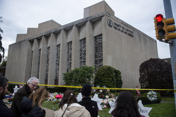 Members of Pittsburgh and the Squirrel Hill community pay their respects at the memorial to the 11 victims of the Tree of Life Synagogue massacre last Saturday.