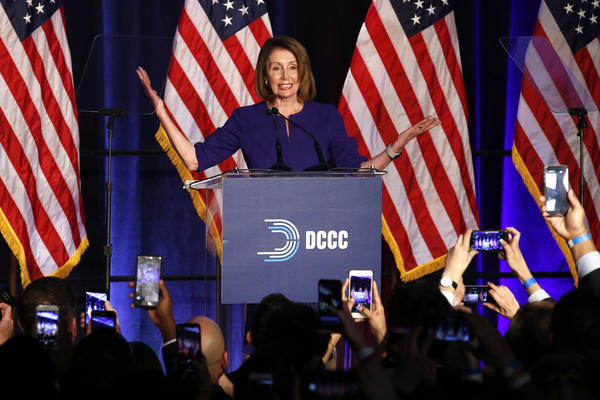 House Minority Leader Nancy Pelosi of California smiles as she is cheered by a crowd of Democratic supporters during an election night returns event in Washington, D.C., on Tuesday.