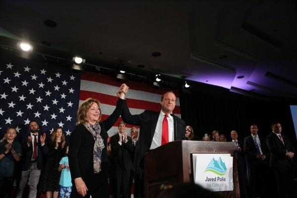 Governor-elect Jared Polis with running mate Dianne Primavera at the Democratic watch party in Denver.