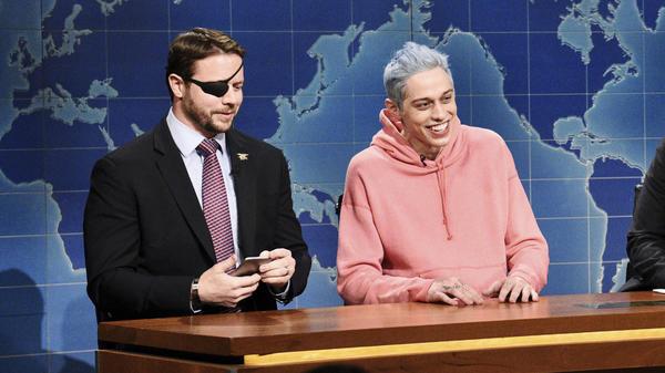 Republican Dan Crenshaw, left, a congressman-elect from Texas, appears next to comedian Pete Davidson during <em>Saturday Night Live</em>.