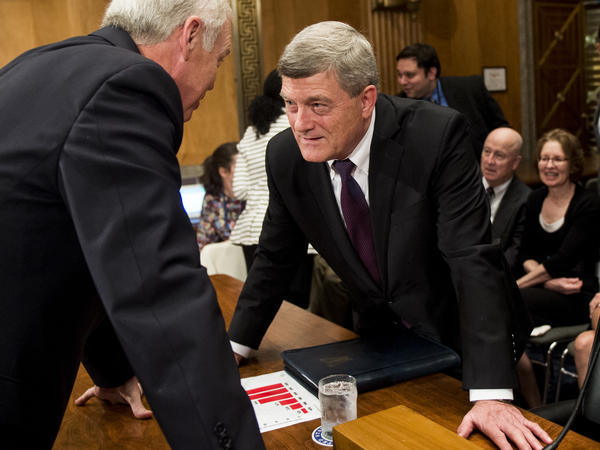President Trump's nominee for Census Bureau director, Steven Dillingham (center), speaks with Sen. Ron Johnson, R-Wisc., at his Oct. 3 confirmation hearing before the Senate Homeland Security and Governmental Affairs Committee.