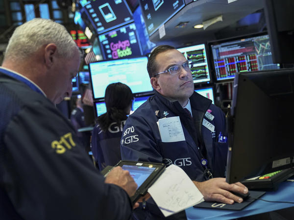 Investors are said to be worried about signs that the global economy may be slowing, even though the U.S. economy is faring well.