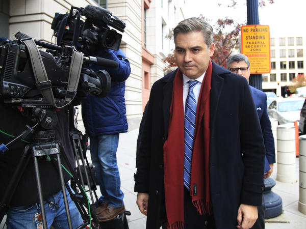 CNN's Jim Acosta walks into federal court in Washington on Wednesday to attend a hearing on a legal challenge against the Trump administration.