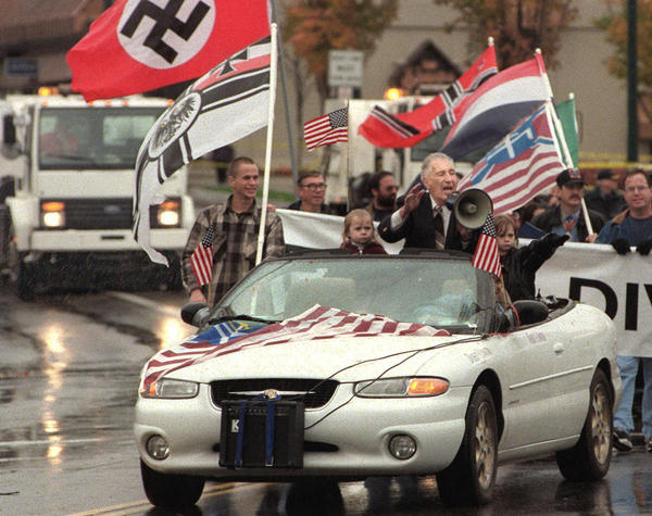 In this Oct. 28, 2000 file photo, white supremacist Richard Butler, speaks through a megaphone at an Aryan Nations rally in Coeur d'Alene, Idaho. The Aryan Nations is long gone from northern Idaho, but its reputation lingers to the chagrin of locals.