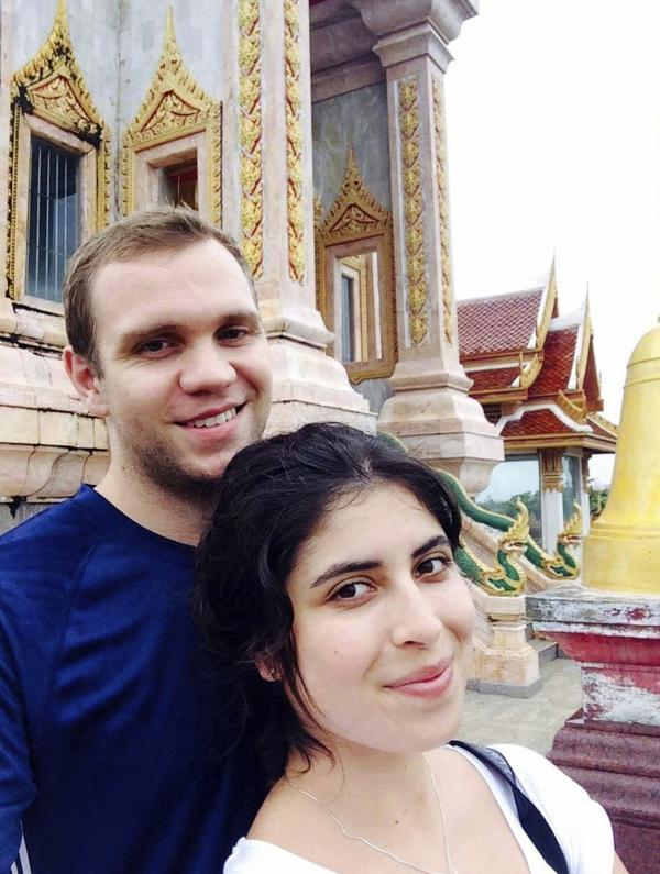 This undated family photo shows Matthew Hedges with his wife, Daniela Tejada. On Wednesday, Hedges was convicted of spying and given a life sentence by a court in the United Arab Emirates.