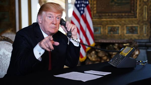 President Trump speaks to members of the military over the phone Thursday from his Mar-a-Lago resort in Palm Beach, Fla.