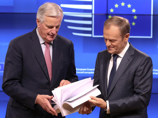 European Union chief Brexit negotiator Michel Barnier, left, and European Council President Donald Tusk flip through the pages of a draft agreement on Thursday, Nov. 15, in Brussels.