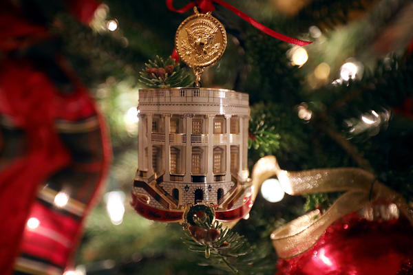 The White House Historical Association's official 2018 Christmas ornament hangs on a tree in the White House library on Monday.
