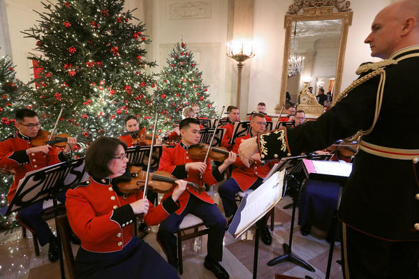 The United States Marine Band performs holiday music in the decorated Grand Foyer at the White House on Monday.
