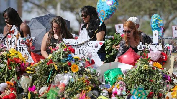 Mourners pay tribute to victims of the Marjory Stoneman Douglas High School shooting back in February. The FBI is changing its procedures after mishandling two tips that might have prevented the massacre.