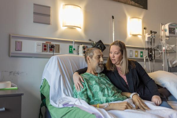 Shauna Pelfrey talks to her husband, Dorian, while preparing for his dialysis appointment.