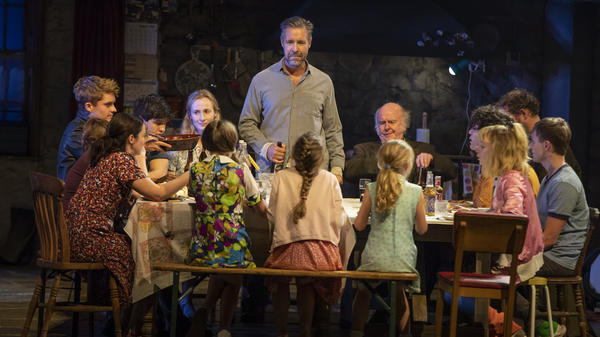 "<em>The Ferryman </em>follows the large family of a man who was ""disappeared"" in the Northern Ireland conflicts of the late 20th century. Paddy Considine (standing) plays Quinn, the head of the family and the brother of the dead man."