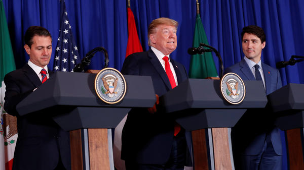President Donald Trump signed the USMCA trade deal on Friday, alongside Canada's Prime Minister Justin Trudeau and Mexico's President Enrique Peña Nieto in Buenos Aires.