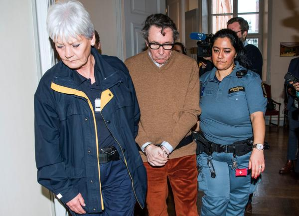 Jean-Claude Arnault is escorted on Nov. 12 after the first day of his appeal trial in Stockholm. Arnault challenged his conviction for rape, but instead of throwing out the conviction, the appeals court extended his sentence.