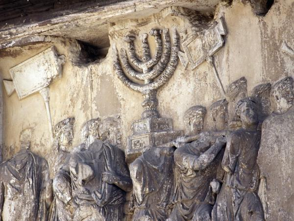 A relief under Rome's Arch of Titus, built in the first century, shows a menorah being taken away from the Temple in Jerusalem.