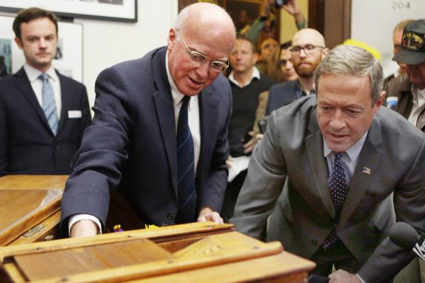 New Hampshire secretary of state Bill Gardner, left, shows former Maryland Gov. Martin O'Malley, the historic ballot box before O'Malley filed papers to run in the 2016 presidential primary. Gardner is the nation's longest-serving secretary of state and has jealously guarded New Hampshire's first-in-the-nation presidential primary.