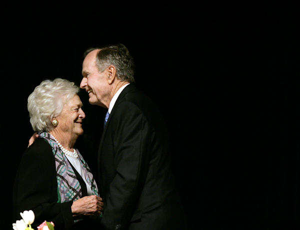 In this May 3, 2006 photo, former President George H.W. Bush embraces former first lady Barbara Bush after she introduced him at the Genesis Women's Shelter Mother's Day Luncheon in Dallas.