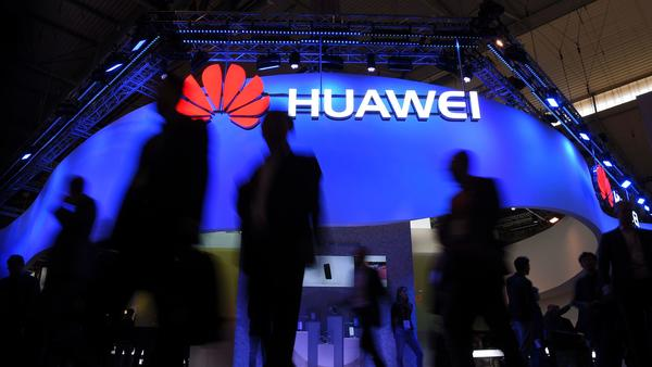 Visitors pass a Huawei marquee in Barcelona during the Mobile World Congress last year. The daughter of the Chinese telecommunications giant's founder was arrested Saturday in Canada on U.S. request, in a move that threatens to inflame U.S.-China trade tensions.