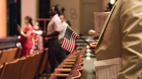 Newly sworn-in U.S. citizens stand during a naturalization ceremony in Alexandria, Va., in August. The Census Bureau is planning to test how a question about U.S. citizenship status the Trump administration added will affect responses to the 2020 census.