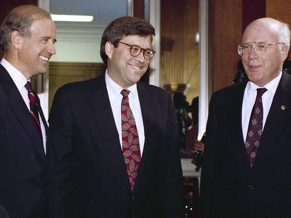 Attorney general nominee William Barr (center) chats with then-Sen. Joe Biden and Sen. Patrick Leahy, D-Vt., before Barr's hearing on Nov. 12, 1991.