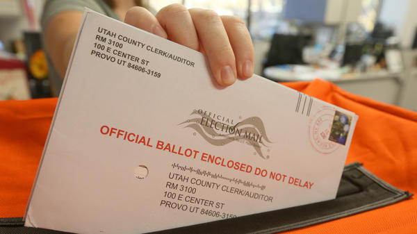 An employee at the Utah County Election office puts mail in ballots into a container to register the vote in the midterm elections on November 6.