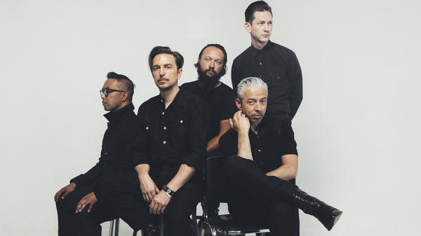 Singer-songwriter JD McPherson (second from left) plays with Raynier Jacildo, Jimmy Sutton, Jason Smay and Doug Corcoran on the album <em>Socks</em>.