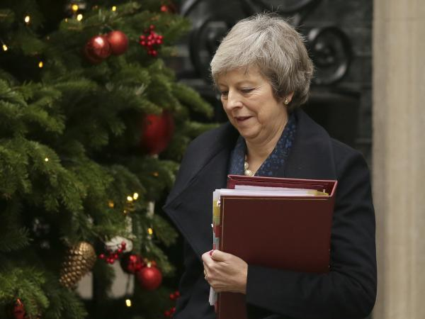 Britain's Prime Minister Theresa May leaves No. 10 Downing St. to attend the weekly Prime Ministers' Questions session on Wednesday.