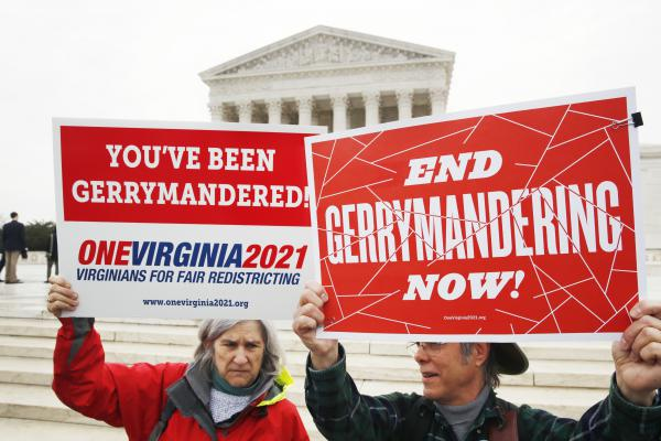 Anti-gerrymandering activists outside the Supreme Court in March, before the court heard arguments on a gerrymandering case. While the Supreme Court ultimately punted on deciding whether partisan gerrymandering was legal, the issue took on a political life of its own this year.