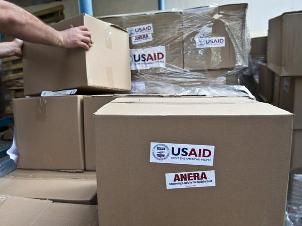 Sanitation kits and soap provided by USAID is transported for displaced people in Gaza City on Aug. 15, 2014. The Trump Administration has slashed more than half a billion dollars to the Palestinians this year.