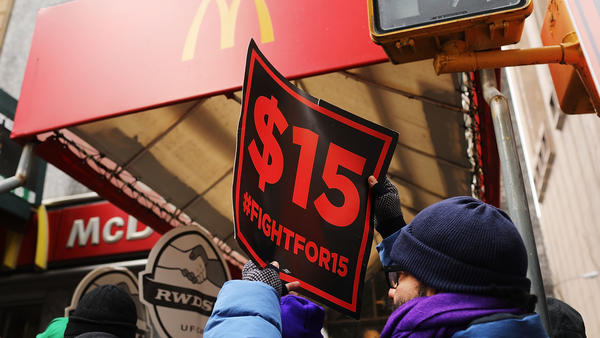 Protesters with NYC Fight for $15 gather in front of a McDonalds to rally against fast food executive Andrew Puzder, who was President Trump's nominee to lead the Labor Department on February 13, 2017 in New York City.