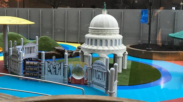 The playground of the new day care facility for staff and lawmakers in the House of Representatives evokes the skyline and the many monuments of official Washington.