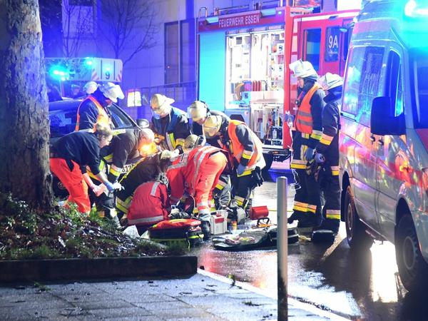 Paramedics and an emergency doctor bend over a man who had been run over by a car near the Museum Folkwang in North Rhine-Westphalia, Essen, on Tuesday.