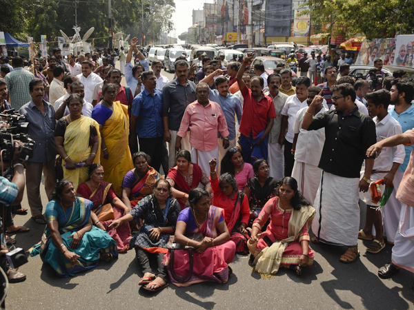 Protesters in Kerala's capital city of Thiruvananthapuram block traffic and shout slogans reacting to reports of two women of menstruating age entering the Sabarimala temple, one of the world's largest Hindu pilgrimage sites, on Wednesday.