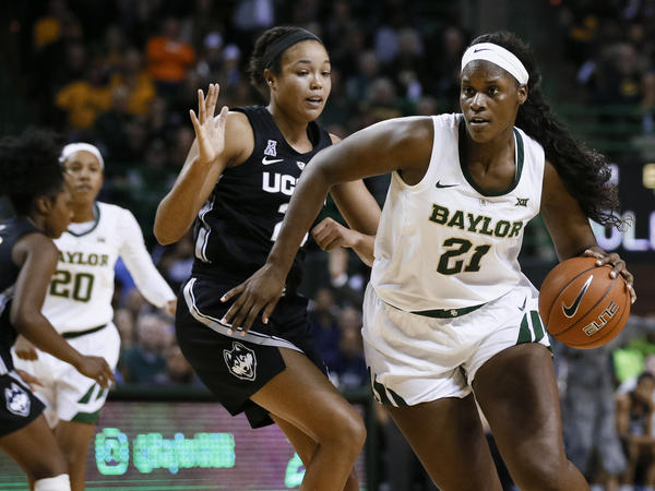 Baylor University center Kalani Brown (21) works around University of Connecticut forward Napheesa Collier during the second half of the NCAA game Thursday in which Baylor defeated UConn 68-57.