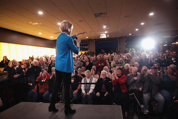 Sen. Elizabeth Warren, D-Mass., speaks to potential voters during a campaign stop on Friday in Council Bluffs, Iowa.