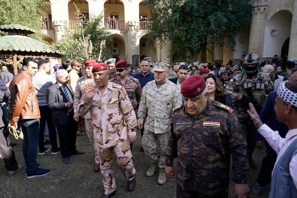 U.S. Marine Brig. Gen. Austin Renforth (center) went with his Iraqi counterpart, Lt. Gen. Jalil Jabbar al-Rubaie (center left), for a tour of Baghdad's most crowded neighborhoods on Friday.