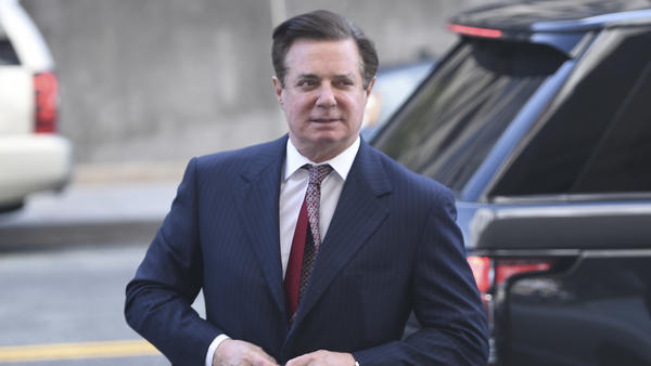 Paul Manafort arrives for a hearing at U.S. District Court in Washington, D.C., on June 15. A new court filing says Manafort is suspected of having shared polling data with a business associate who has links to the Russian intelligence service.