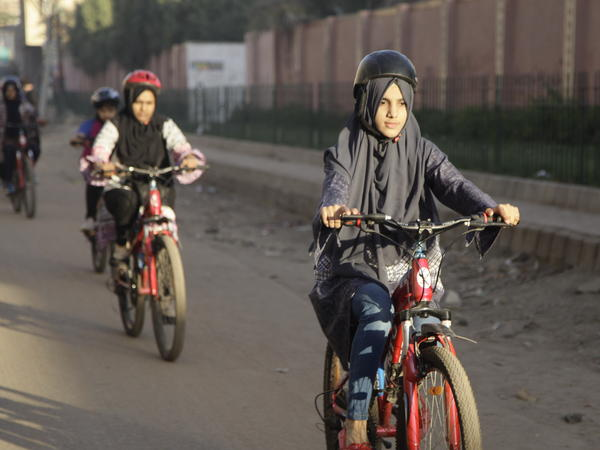 Zulekha Dawood leads the group of female cyclists through the impoverished Lyari neighborhood in Karachi, Pakistan. They ride early in the morning to avoid the worst of the traffic.