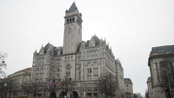 The Old Post Office Pavilion Clock Tower, seen above the Trump International Hotel in Washington, remains open despite the partial government shutdown.