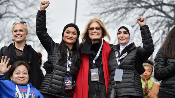 Ginny Suss, Carmen Perez, Gloria Steinem, Linda Sarsour and Mia Ives-Rublee appear at the first Women's March in Washington, D.C., the day after President Trump's 2017 inauguration. Two years later, divisions in the movement have dampened the 2019 events.