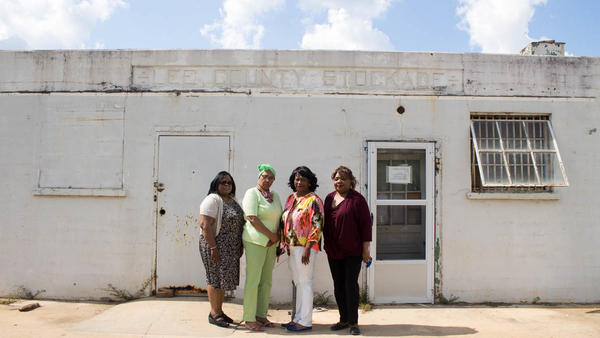 Taken in 2016, (left to right) Emmarene Kaigler-Streeter, Carol Barner-Seay, Shirley Green-Reese and Diane Bowens stand outside the stockade building in Leesburg, Ga., where they were jailed in 1963.
